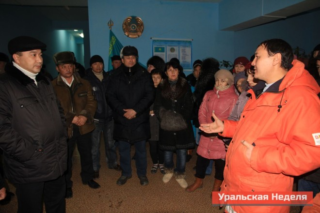"Already after the villagers gathered in the yard, the local akim finally allowed them to hold a meeting in the lobby of the local cultural center. Burlin District Deputy akim (governor) Azamat Safimaliev was present at the meeting. The villagers demanded that he suspend all classes at the local school until the end of the investigation, and to require the doctors to disclose the results of the assessments of the affected children. Local residents demanded him to stop classes at a local school before the end of the investigation and to oblige doctors handed out a survey to parents of affected children. Azamat Safimaliev urged the villagers to wait for the completion of the investigation and environmental assessment, as it is impossible to establish the true cause of the incidents. In addition, he also promised that every day residents of Berezovka would receive from him or the local akim full information about what is happening in Berezovka, including the status of children. ""You can see different rumors about the numbers of affected children spread through the village. You will receive accurate information. I'll guarantee it, ""- said Azamat Safimaliev. (Photo courtesy of Uralskaya Nedelya)"